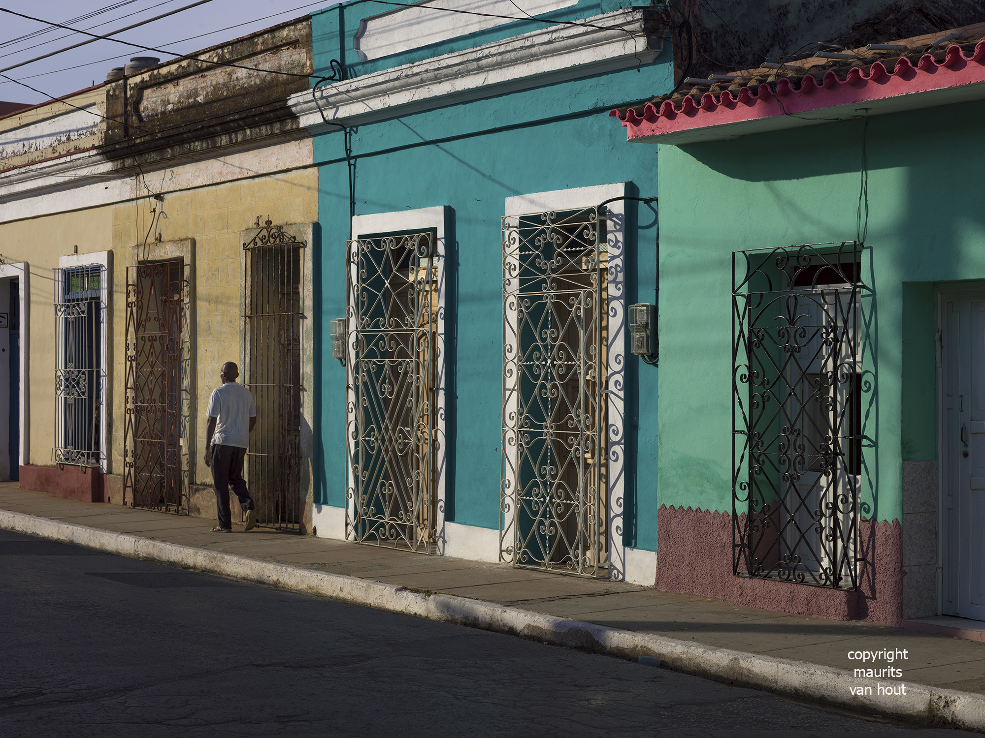 coloured houses in Trinidad Cuba by Dutch photographer Maurits van Hout